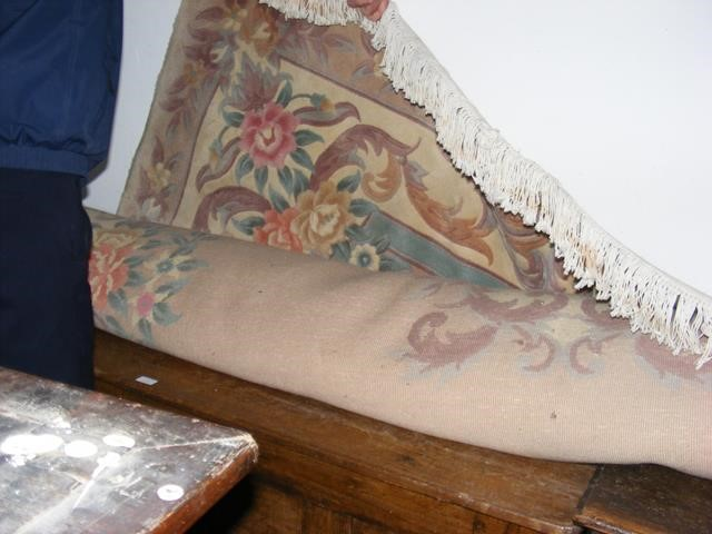 A large Chinese carpet with floral border