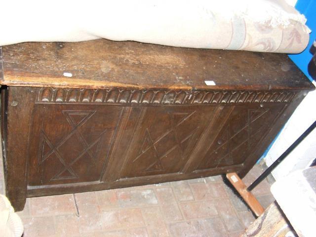 An antique panelled oak coffer - 128cm