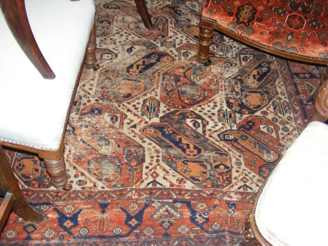 A Middle Eastern rug with geometric border