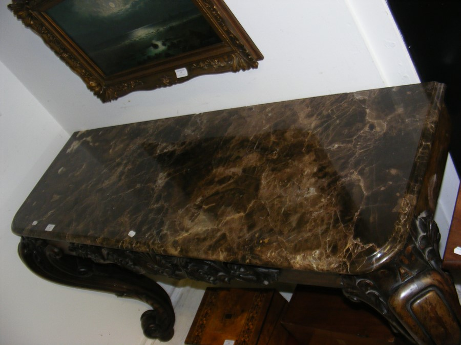 A decoratively carved console table with cabriole - Image 2 of 22