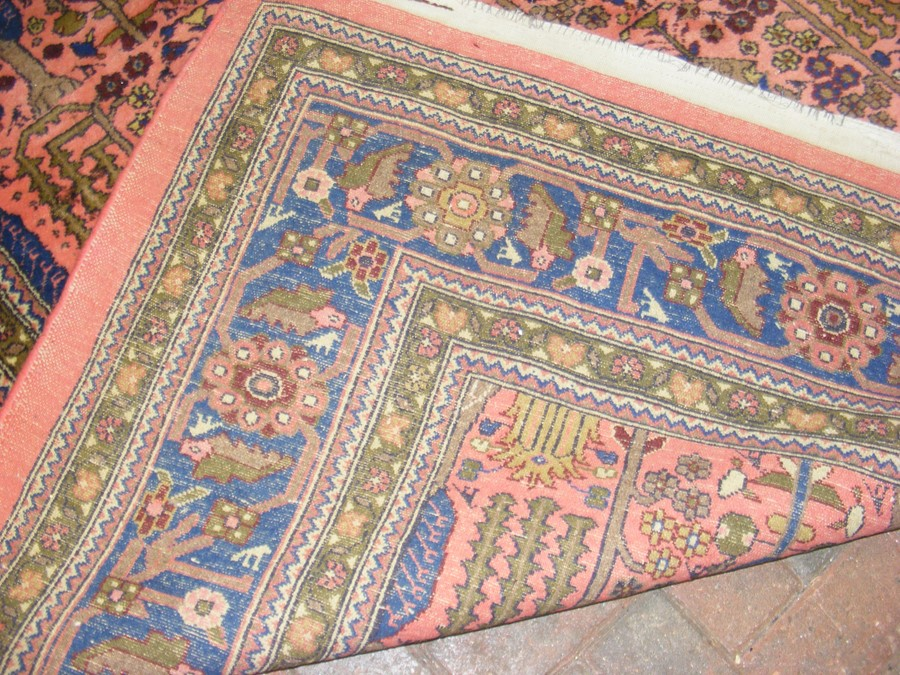 A large Middle Eastern style carpet with geometric - Image 3 of 9