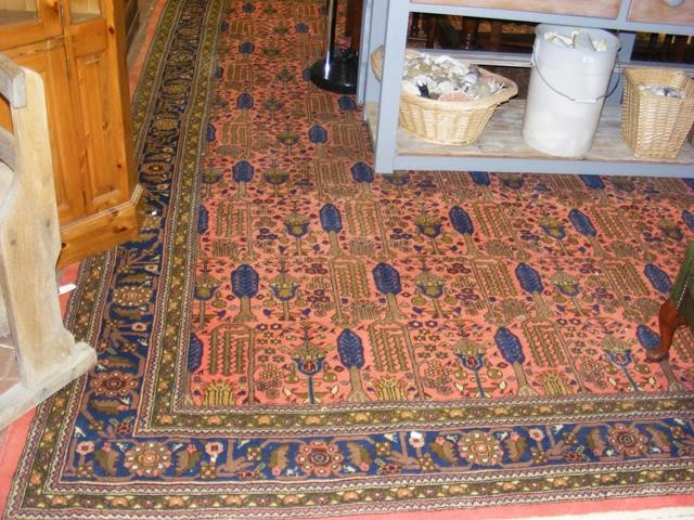 A large Middle Eastern style carpet with geometric