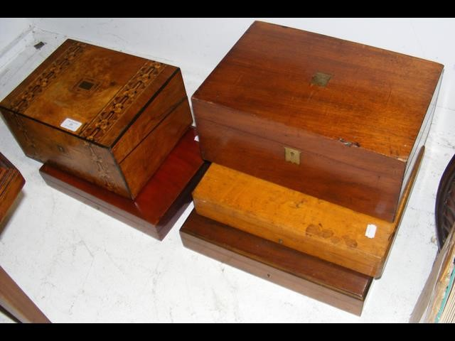 An inlaid box, together with others