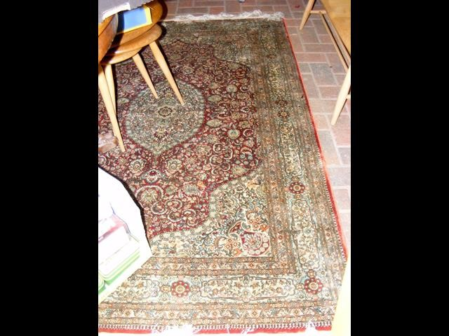 A finely woven Middle Eastern rug with geometric b
