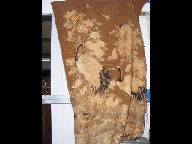 An old oriental tapestry with exotic birds and flo