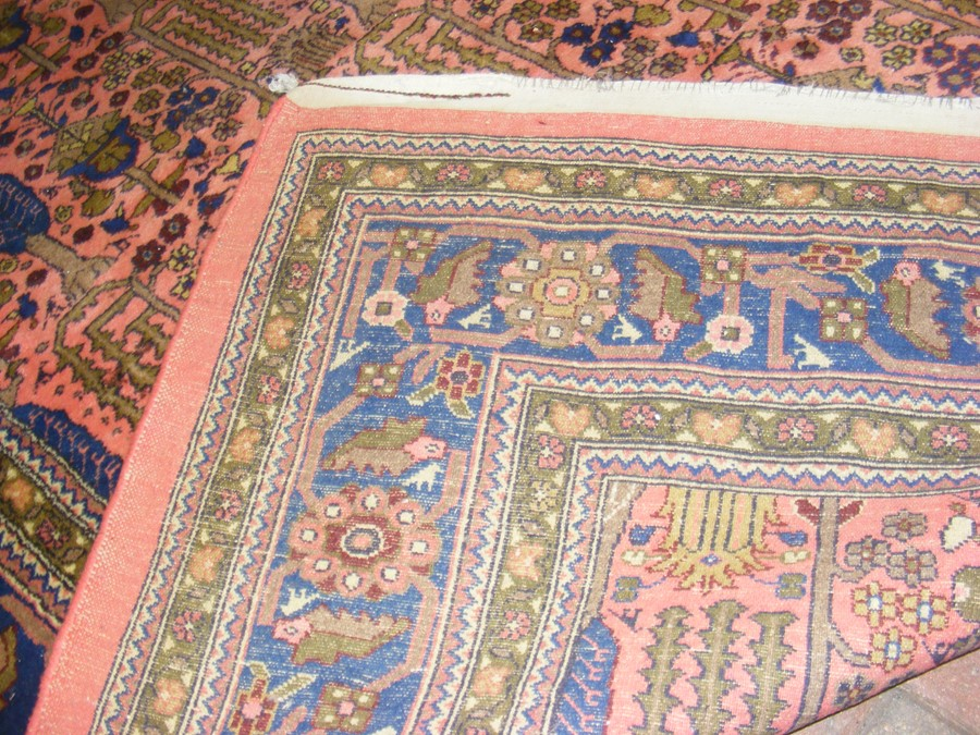 A large Middle Eastern style carpet with geometric - Image 7 of 9