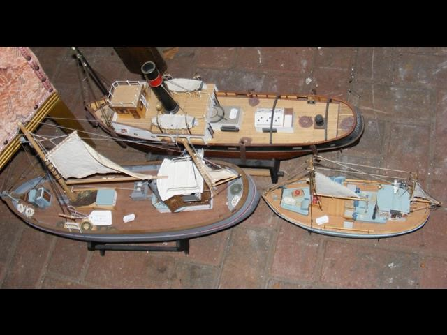 A model steamship, together with two others