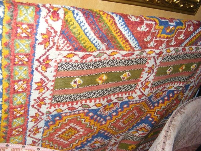 A Middle Eastern style carpet with geometric borde