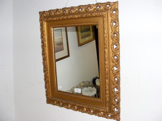 A small antique gilt framed wall mirror - 55cm x 4