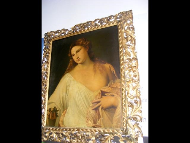 An antique oil on canvas entitled 'Flora' in decorativ