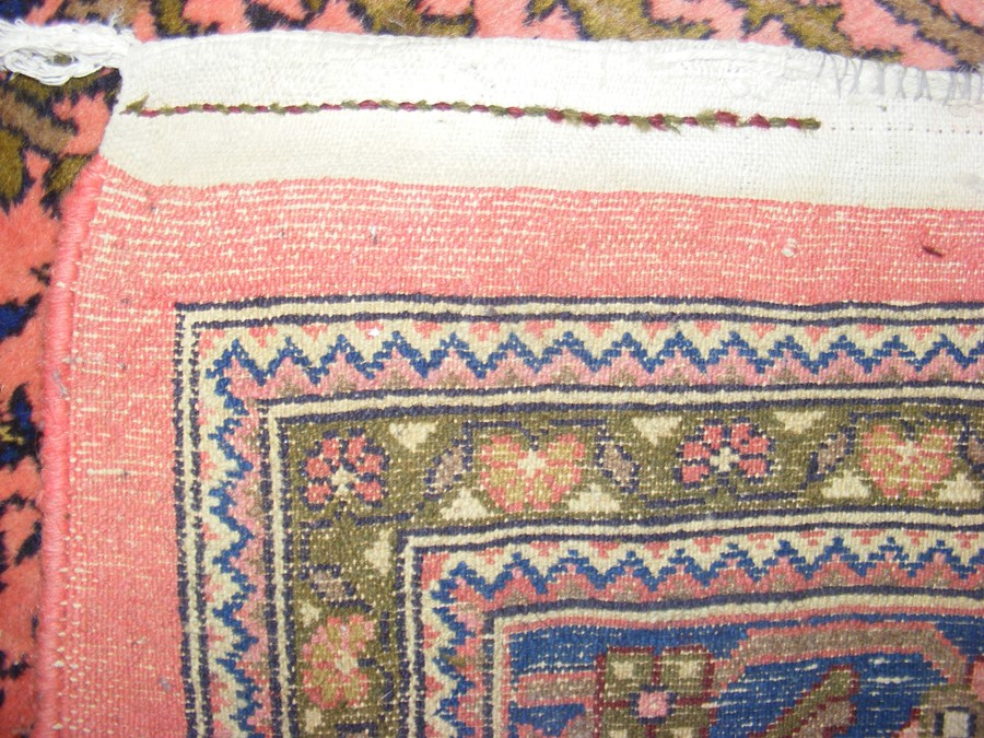 A large Middle Eastern style carpet with geometric - Image 2 of 9