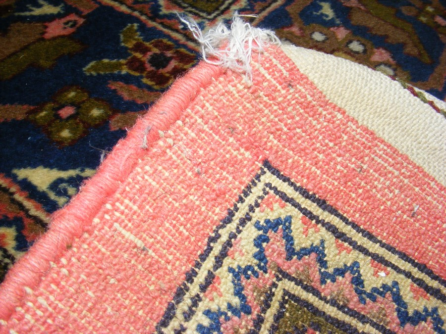 A large Middle Eastern style carpet with geometric - Image 9 of 9