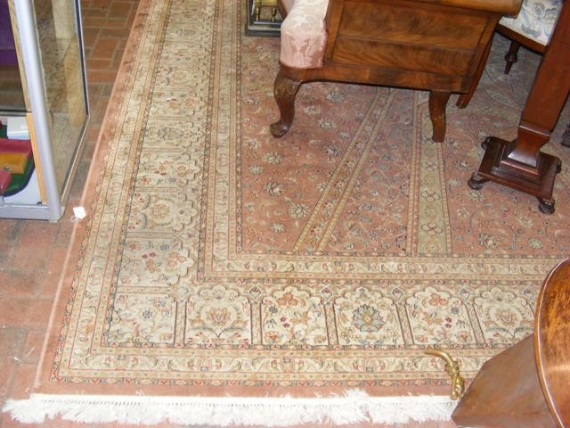 A Middle Eastern style carpet with geometric flora
