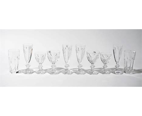 A part suite of Baccarat crystal stemware, comprising; twenty champagne flutes, 18cm high, ten wine glasses, 13.5cm high, thi