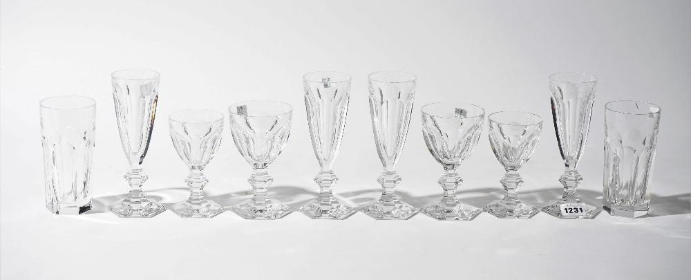 A part suite of Baccarat crystal stemware, comprising; twenty champagne flutes, 18cm high,