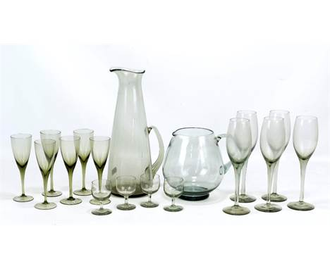 A group of Swedish and Danish glass comprising a set of six Orrefors 'Mirabel' smoked grey wine glasses, a similar set of fou