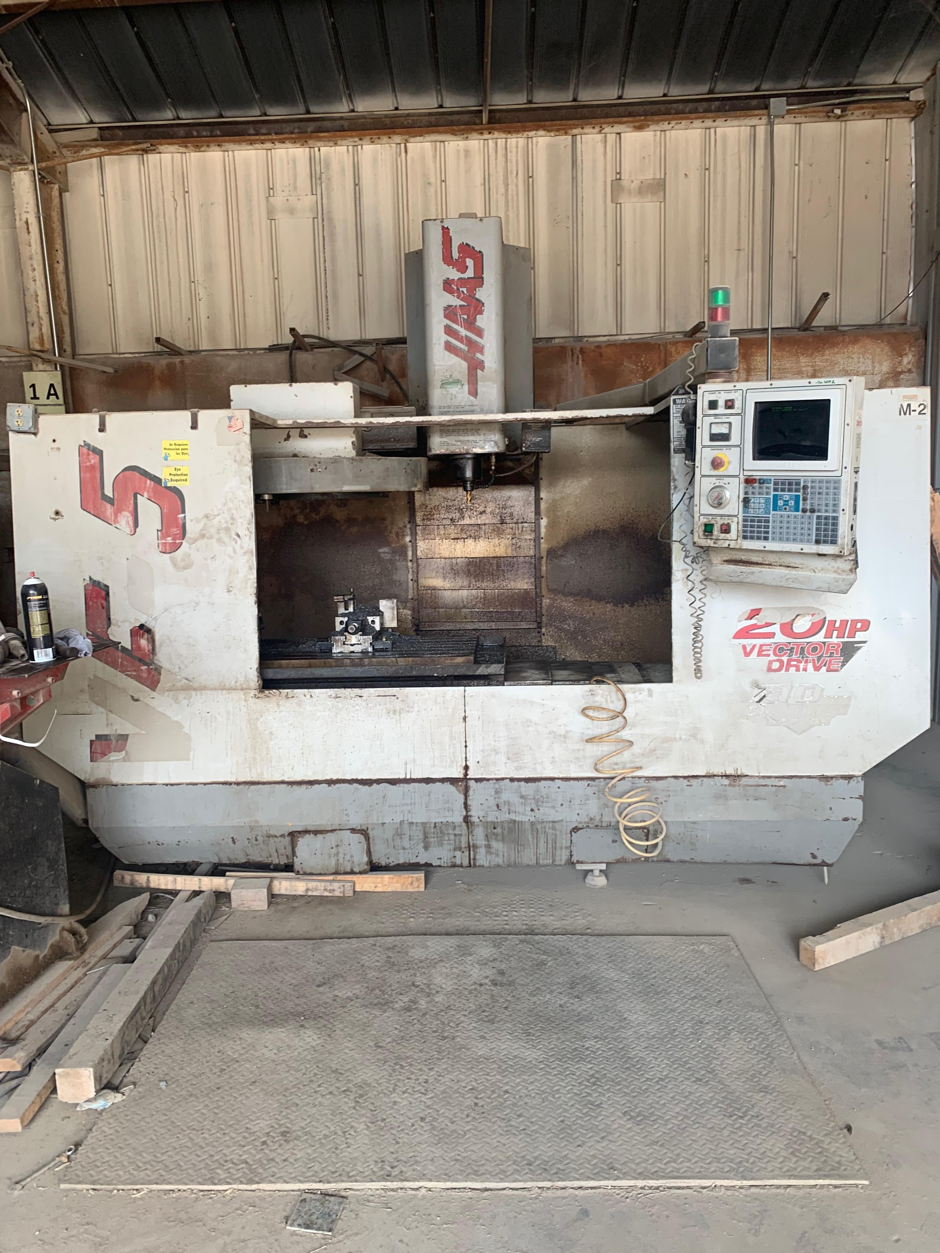 "Lot 111A - 1999 Haas VF5 Vertical Machining Center, 52"" x 23"" Table, Travels: X: 50"", Y: 26"", Z: 25"""