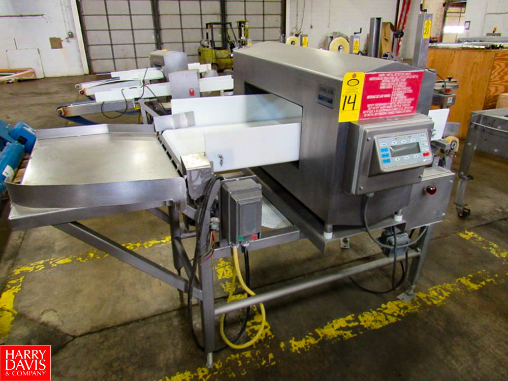 "Goring Kerr Metal Detector, 23 3/4"" W X 9 3/4"" H aperture, 22"" W X 54"" L plastic belt conveyor,"