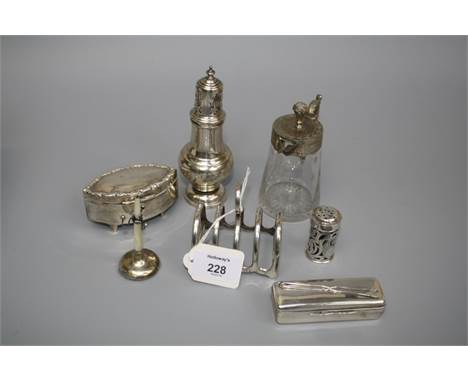 A group of small silver items, to include a four slice toastrack, ring tree, sugar castor, pepper, ring box and hair pin box,