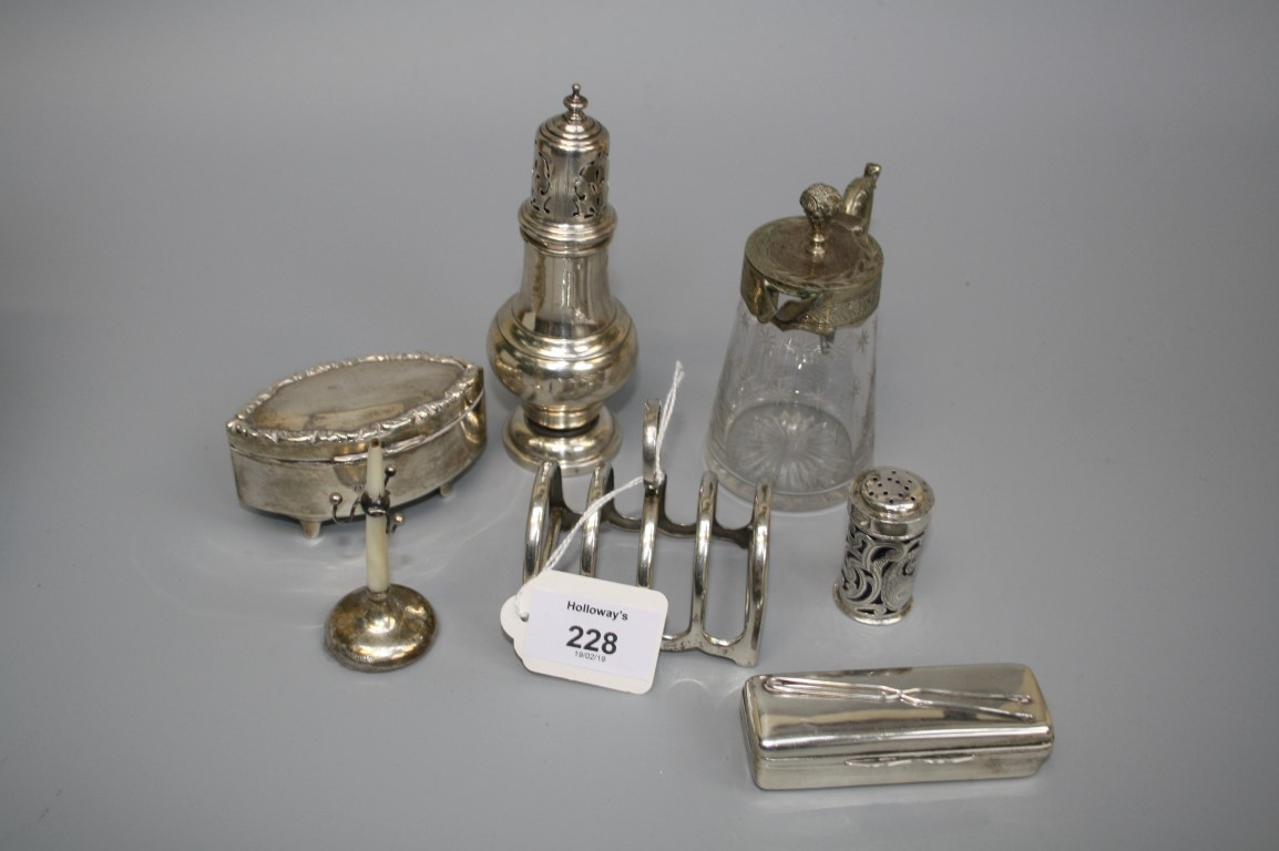 A group of small silver items, to include a four slice toastrack, ring tree, sugar castor, pepper,