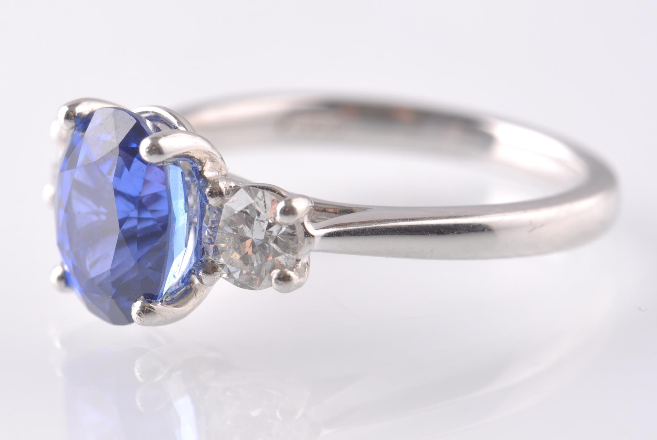 A PLATINUM SAPPHIRE & DIAMOND THREE STONE RING. - Image 2 of 5