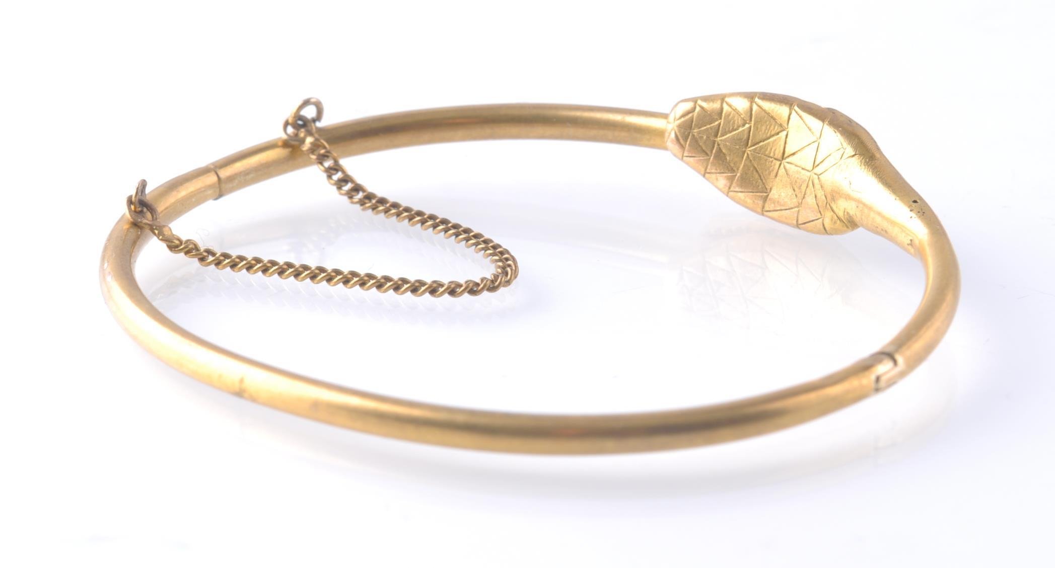 AN ANTIQUE OUROBOROS GOLD AND RUBY SNAKE BANGLE - Image 3 of 4