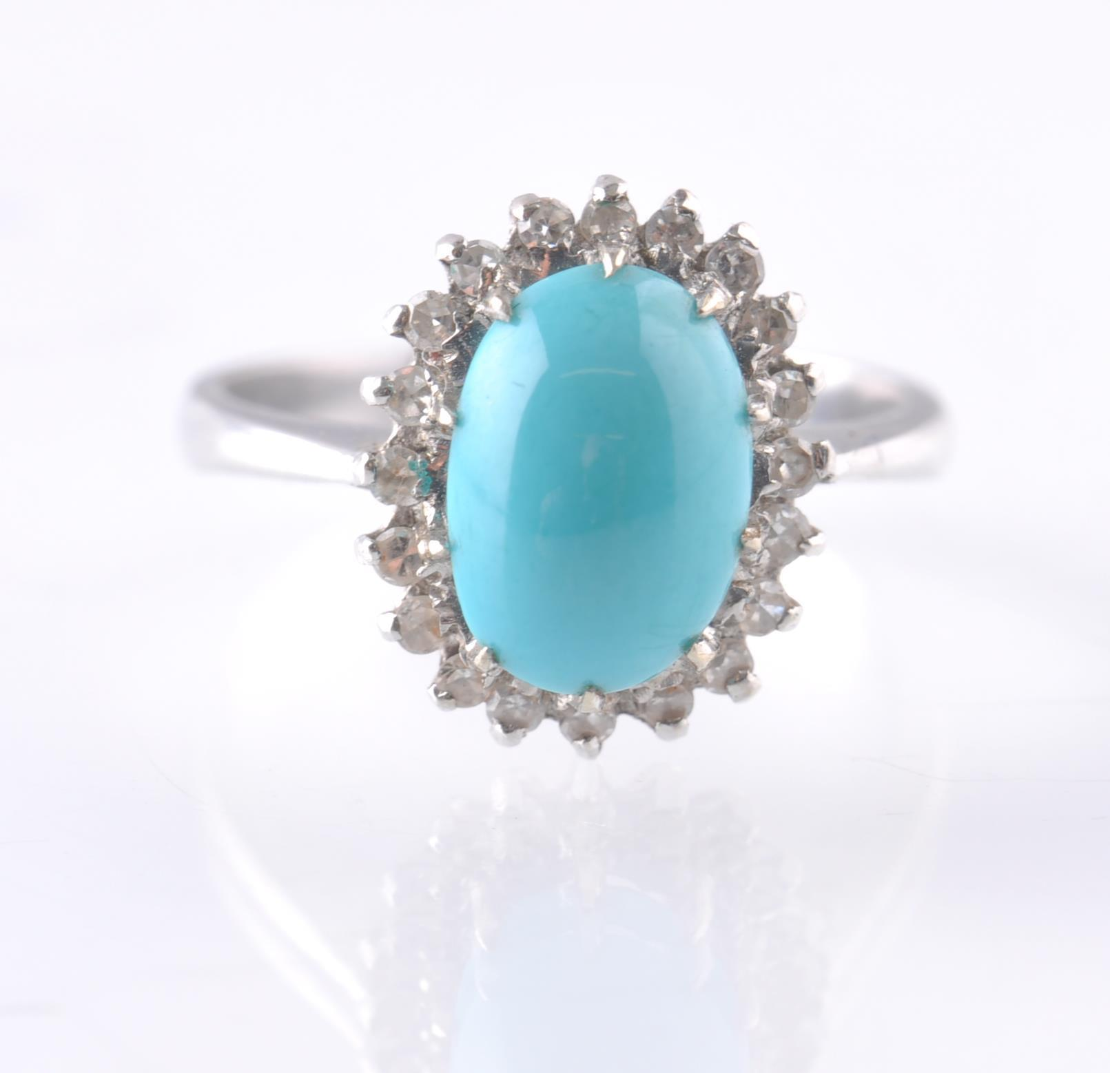 AN 18CT WHITE GOLD TURQUOISE AND DIAMOND OVAL CLUS