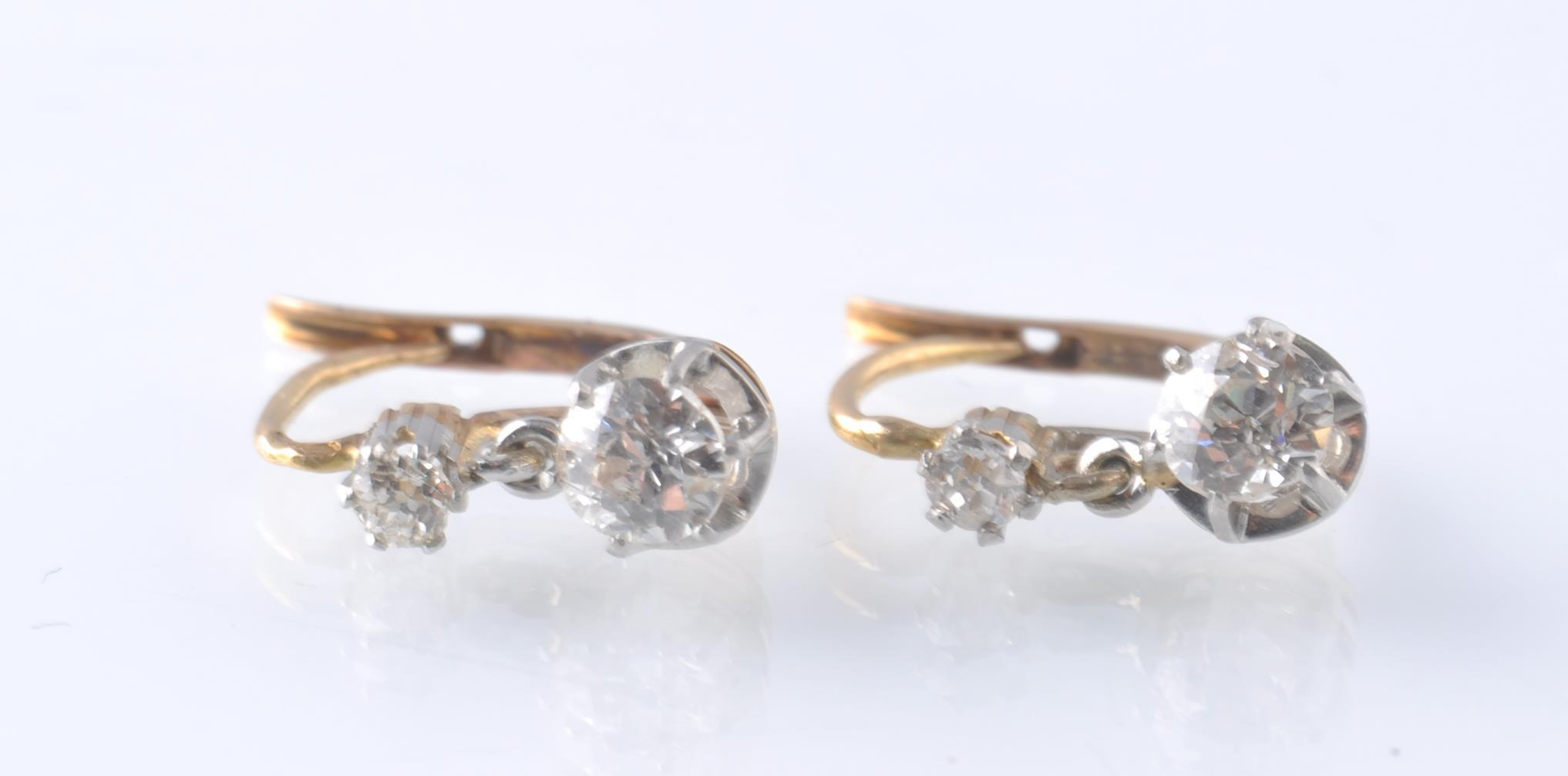 A PAIR OF FRENCH 18CT GOLD PLATINUM AND DIAMOND DR