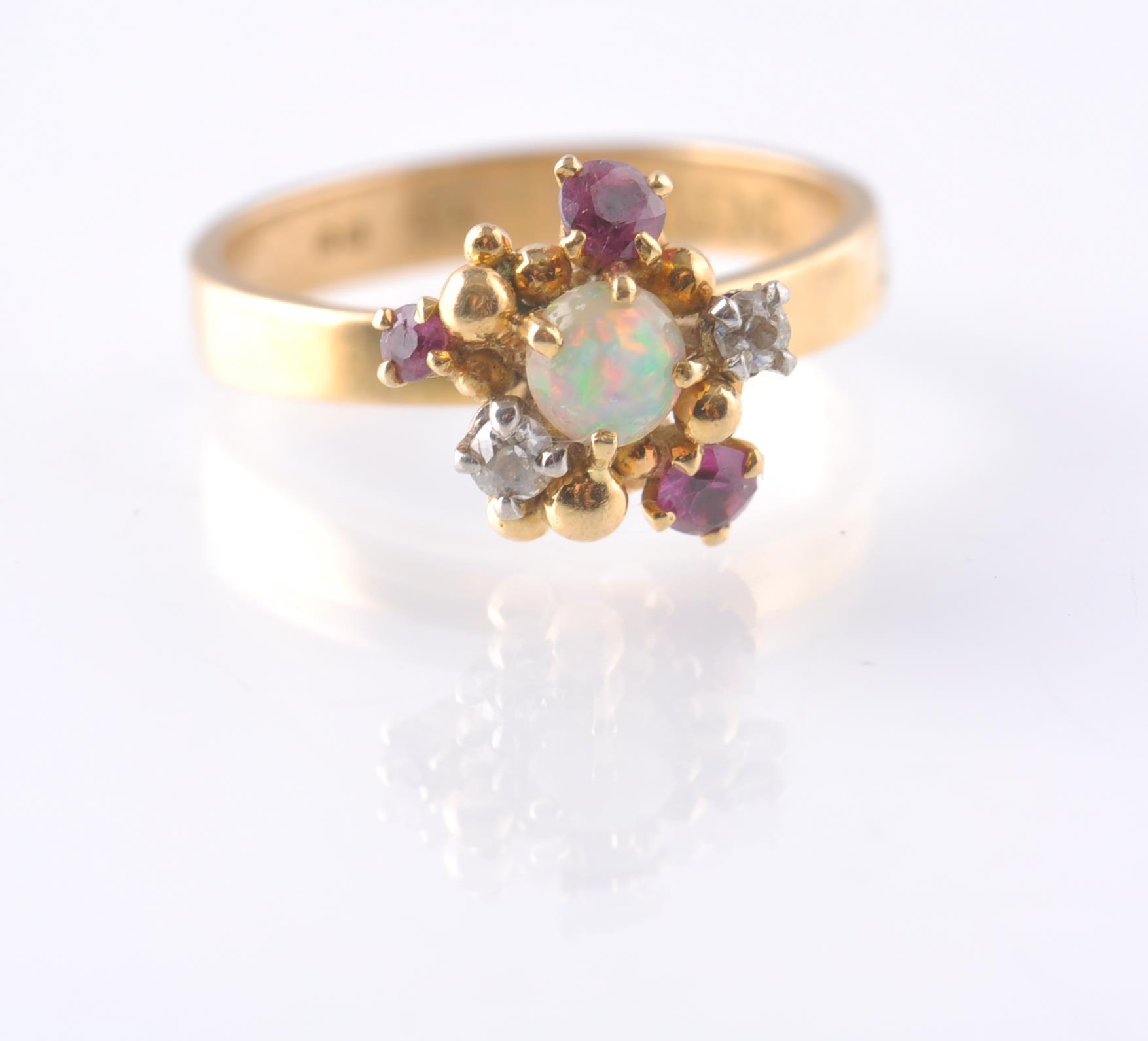 A HALLMARKED OPAL RUBY AND DIAMOND CLUSTER RING