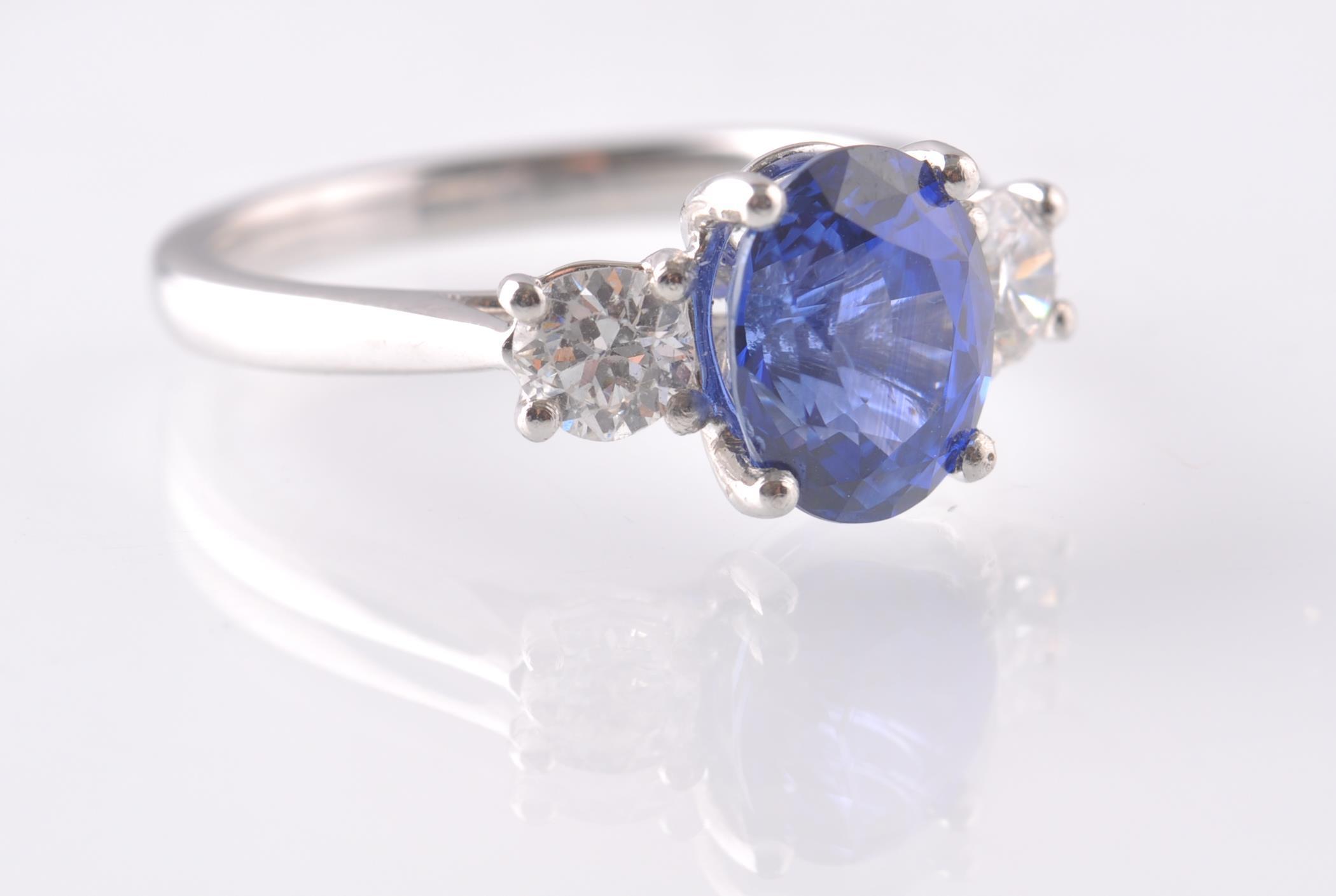 A PLATINUM SAPPHIRE & DIAMOND THREE STONE RING. - Image 3 of 5