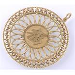 A LARGE GOLD CHINESE PENDANT