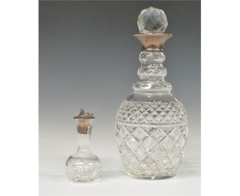 Modern hallmarked silver-mounted cut glass decanter, height 28cm, and a small cut glass vessel with hallmarked silver fox mas