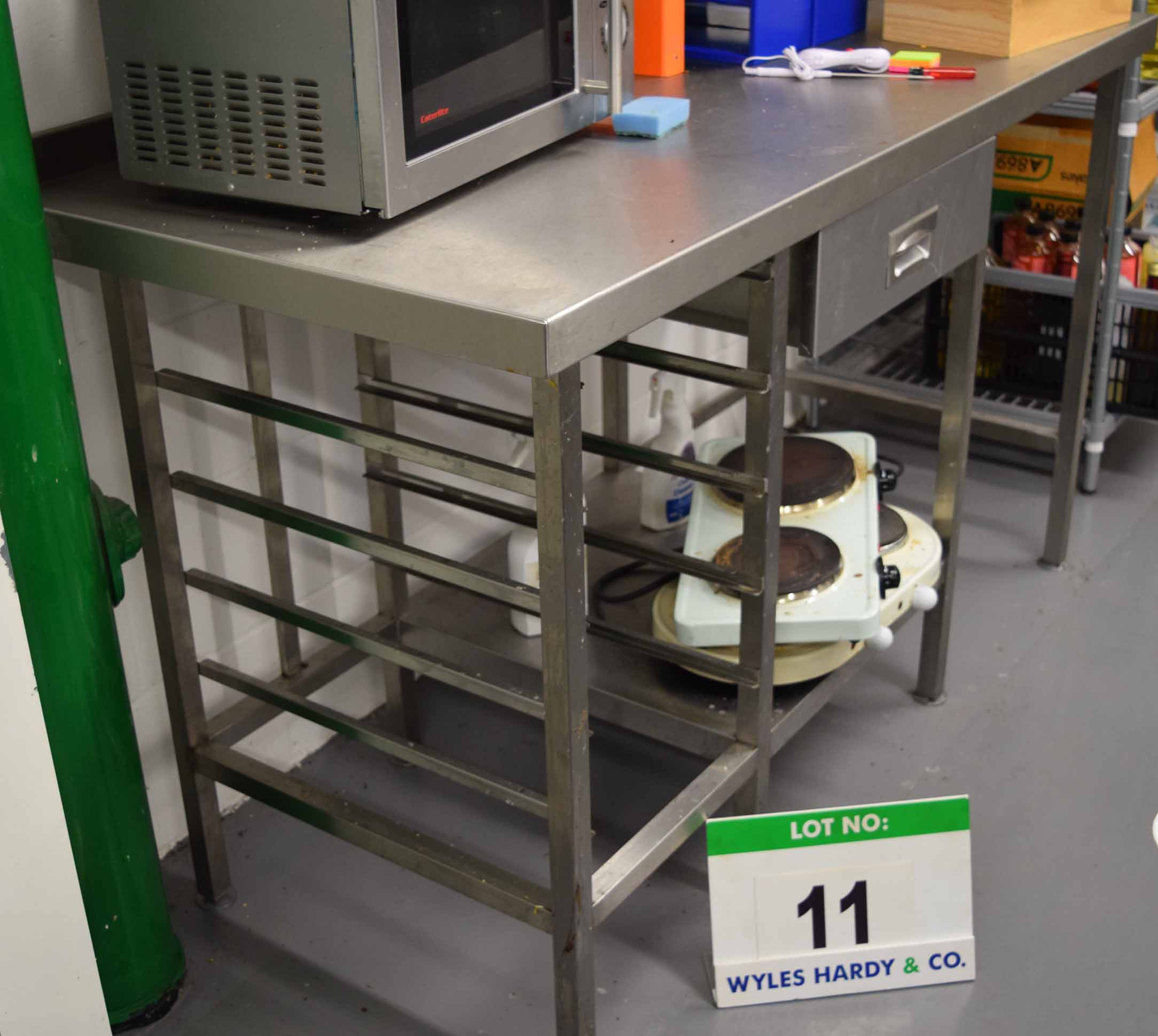 Lot 11 - A 1500mm x 680mm Stainless Steel Preparation Table with Rack Shelves to One Side and Single Drawer