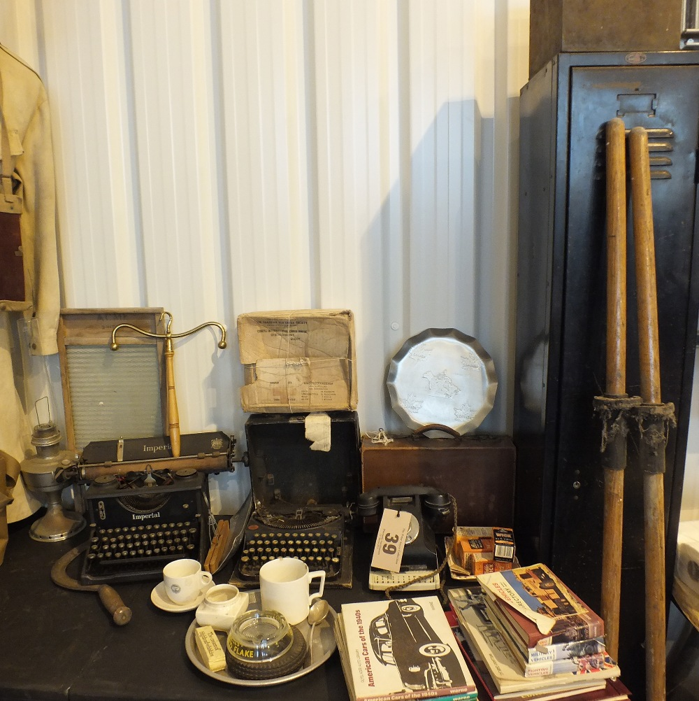 Lot 39 - A large group of vintage items including typewriters, Bakelite telephone, washboard and clothes hanger etc