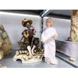 A TINTED BISQUE FIGURE OF A CHOIR BOY AND A CAPO DI-MONTE FIGURE OF A TRAMP FEEDING A SQUIRREL (2)