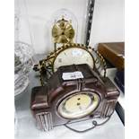 AN ANNIVERSARY CLOCK WITH GLASS DOME SHADE, A SPRING DRIVEN MANTEL CLOCK IN METAL FRAME AND A
