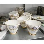 AN EARLY 1950's BONE CHINA 21 PIECE GOLD DECORATED TEA SERVICE (21)