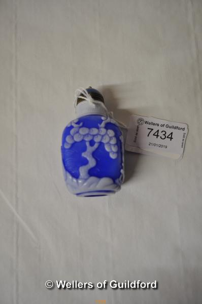 Lot 7434 - A Chinese pate sur pate scent bottle carved with a man under a tree.