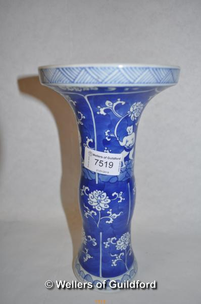 Lot 7519 - A Chinese blue and white sleeve vase decorated with figures, 23cm.