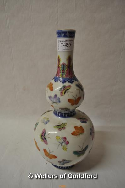 Lot 7480 - A Chinese polychrome double gourd vase decorated with butterflies, 29cm..