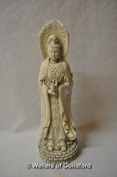 Lot 7515 - A Chinese blanc de chine figure of Guanyin, three figures moulded as one, 41cm.