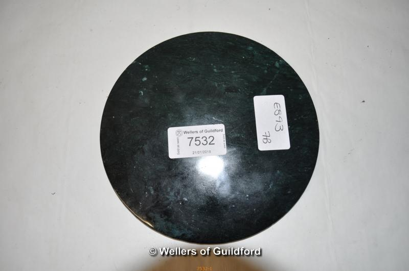 Lot 7532 - A Chinese dark green jade circular disc, carved decoration on one side, 15cm diameter.