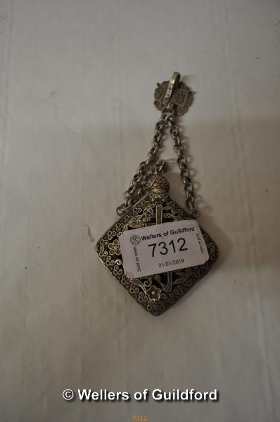 Lot 7312 - A Chinese white metal smellin salts holder with suspension loop.