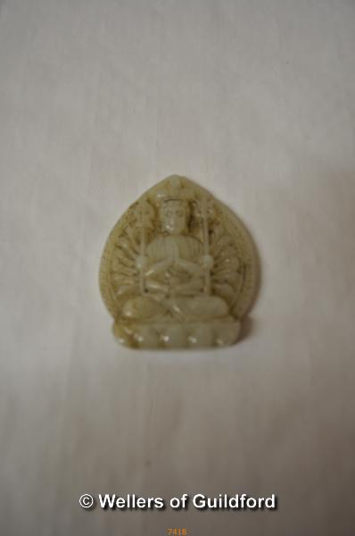 Lot 7418 - A Chinese pale green jade pendant carved with a goddess, 5.5cm.