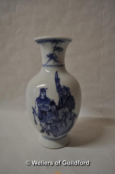 Lot 7530 - A Chinese blue and white baluster vase decorated with three warriors, 15cm.