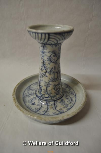 Lot 7478 - A Chinese blue and white candlestick with integral drip tray, 15cm high.