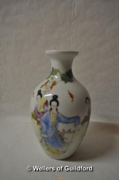 Lot 7518 - A Chinese polychrome baluster vase decorated with figures in a garden, 18cm.