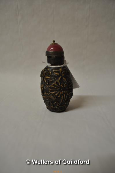 Lot 7437 - A Chinese stone snuff bottle carved all over with fish.
