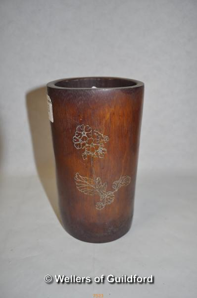 Lot 7523 - A Chinese bamboo brush pot with incised inscripion and floral decoration, 15cm.