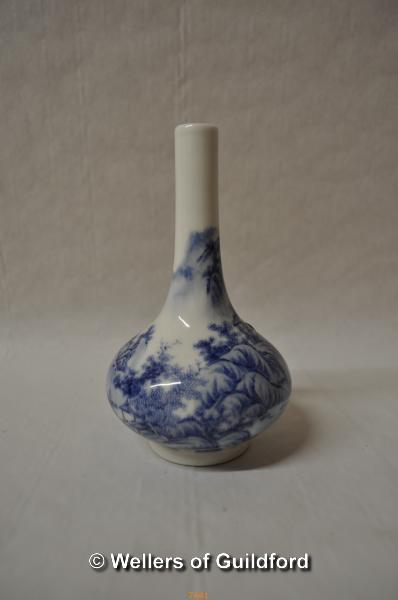 Lot 7441 - A Chinese blue and white bottle vase decorated with mountain village scene, 15cm.